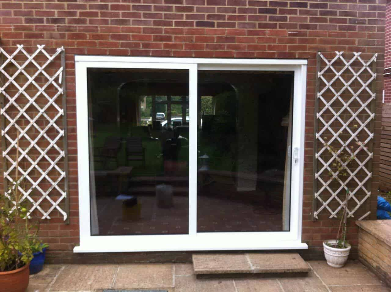 Upvc patio doors pangbourne double glazed doors reading for Patio doors with side windows
